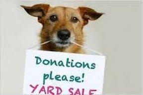 Dog with donation ask sign